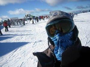 A man wearing a High Uv Buff® as face mask in the snow. He is in a ski resort. © unknown