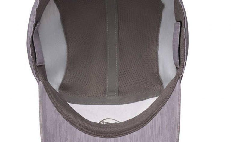 A studio photo of the inside of the Buff® Bimini Cap. It shows the highly ventilating and moisture wicking inlays. It also shows the internal sweatband to keep sweat out of your eyes. Source: buff.eu